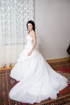 A Beautiful Bride By The Window Stock Photography