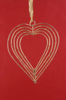 Free Gold Heart On A Red Background Royalty Free Stock Images - 4089669