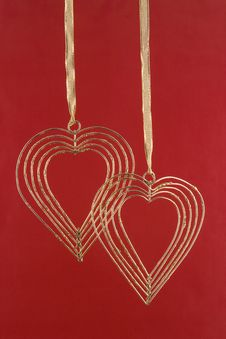 Free Two Gold Hearts On A Red Background Royalty Free Stock Photos - 4089728