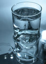 Free Glass Of Water In Dark-blue Royalty Free Stock Photo - 4095705