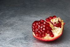 Free Broken Pomegranate On Scratched Metall Stock Images - 4090124