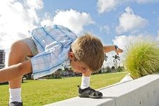 Free Boy Crouched Over Royalty Free Stock Photography - 4090347