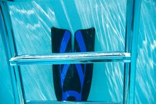 Underwater Pool Ladder And Swim Fin Royalty Free Stock Image
