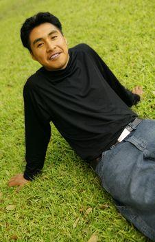 Free Man Sitting On Grass Royalty Free Stock Image - 4091206