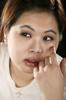 Free Portrait Of Asian Girl With Sad Expression Stock Image - 4091311