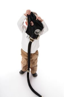 The Kid And A Gas Mask Royalty Free Stock Photo