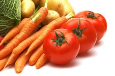 Three Tomatoes And Vegetables Stock Image