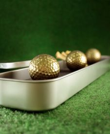 Free Golden Golfballs In Gift Set Stock Photography - 4097482