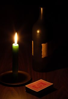 Wine, Candle And Playing Cards Stock Images