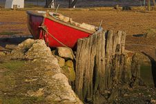 Free Red Rowing Boat Berthed On Land Royalty Free Stock Photography - 411017