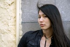 Asian Girl Against Wall Royalty Free Stock Photos