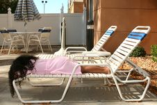Free Young Girl Sleeping By Poolside Stock Photography - 413772