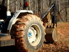 Free Tractor With Backhoe Attachment Stock Images - 4101644