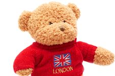 Free Brown Teddy Bear In Red Sweater On White Stock Images - 4103934