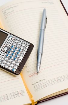 Free Pencil And Smart Phone On Appointment Book Stock Photos - 4104043