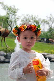 Free Lovely Child With A Coronet Of Flowers Royalty Free Stock Photos - 4104848