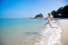 Young Woman Having Fun By The Sea Stock Photography