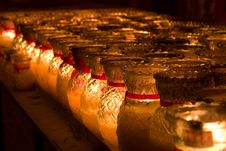 Free Rows Of Candles In Glass Lighted Royalty Free Stock Photos - 4112558
