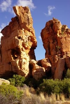 Free Yellow-red Rocks Against Blue Sky Stock Photography - 4116742