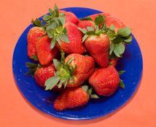 Big Fresh Strawberry On The Blue Dish And Orange B Stock Photo