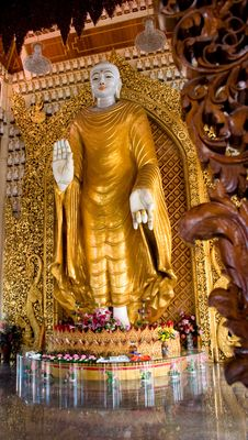 Golden Buddha With Wooden Carving Stock Image