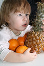 Free Girl, Oranges And The Pineapple Royalty Free Stock Photos - 4128518