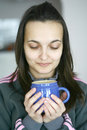 Free An Attractive Female Having A Cup Of Coffee Or Tea Stock Photo - 4129950