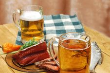 Free Beer And Fish On Table Royalty Free Stock Photo - 4122435