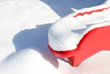Red Plastic Slide In Snow Stock Photo