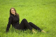 Free Girl Sits On A Green Grass Stock Photo - 4128520
