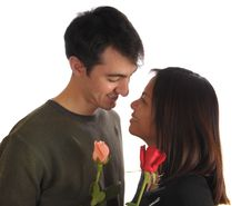Free Young Couple With Roses Stock Image - 4129841