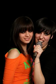Two Girls With A Microphone Royalty Free Stock Photos