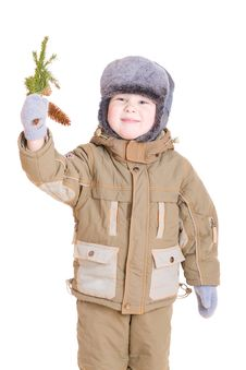A Boy In Winter Coat With A Branch Of Fur Tree Stock Images