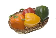 Red, Green, Yellow And Orange Pepper In The Basket Stock Photography