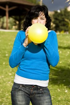 Free Teen Inflating Yellow Balloon Royalty Free Stock Photography - 4134967