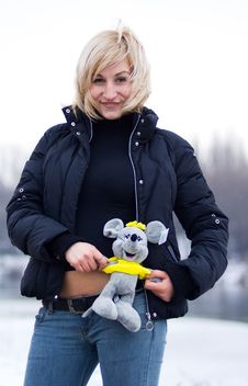 Young Blonde Woman With Toy Rat Stock Images