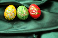 Easter Eggs On Green Satin Fabric Stock Photography