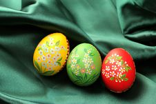 Easter Eggs On Green Satin Fabric Stock Photos