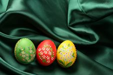 Easter Eggs On Green Satin Fabric Royalty Free Stock Photos