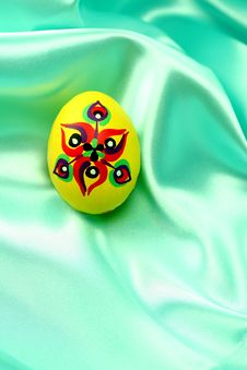 Easter Egg On Turquoise Satin Fabric Stock Photos