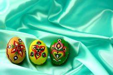 Ornamental Easter Eggs On Turquoise Satin Stock Photo