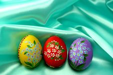 Easter Eggs On Turquoise Satin Fabric Royalty Free Stock Photo