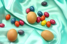 Easter Eggs On Turquoise Satin Fabric Stock Photo