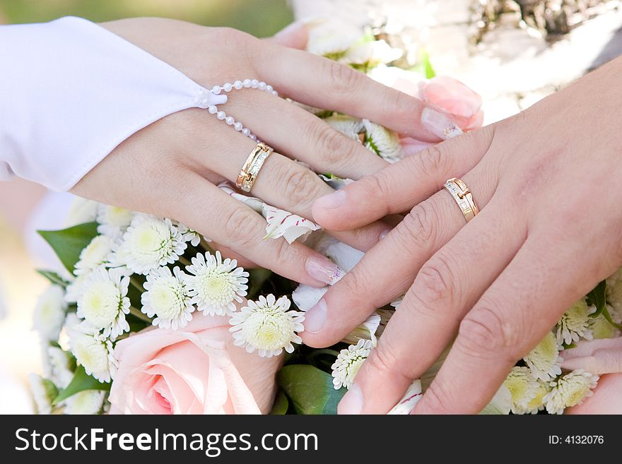 Two Hands With Wedding Rings On The Flower Bouquet Free Stock Images Photos 4132076 Stockfreeimages