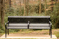 Free Black Iron Bench In Woods Stock Image - 4147381