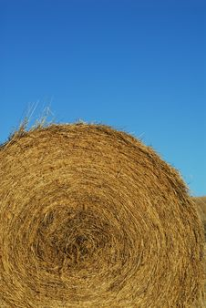 Round Bale Of Hay And Blue Sky Stock Images