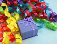 Purple Gift Box With Colorful Curly Ribbons Royalty Free Stock Photo