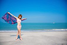 Free Young Girl In Bikini Holding Floral Scarf Stock Images - 4148124