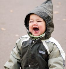 Free Shouting Baby In Green Hood Royalty Free Stock Photography - 4155297