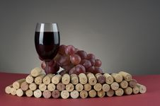 Red Wine Glass With Grape And Corks. Stock Images